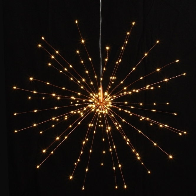 Large Copper Hanging Decorative Starburst Led Light Ornament Lit On Dark Background